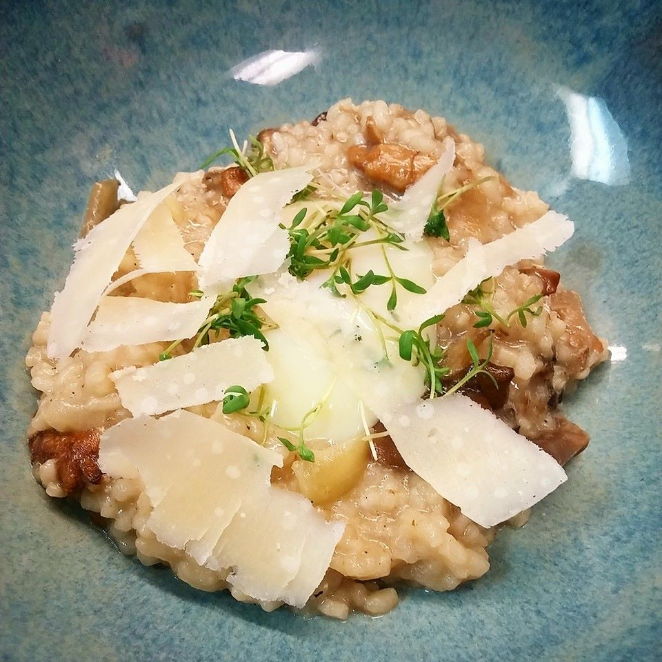 Risotto with local and wild mushrooms, Parmesan, and poached egg | Courtesy of Heritage