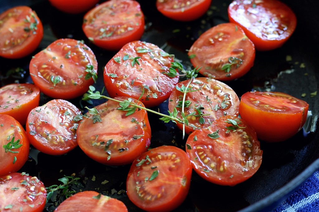 Tomatoes being prepared for a meal.