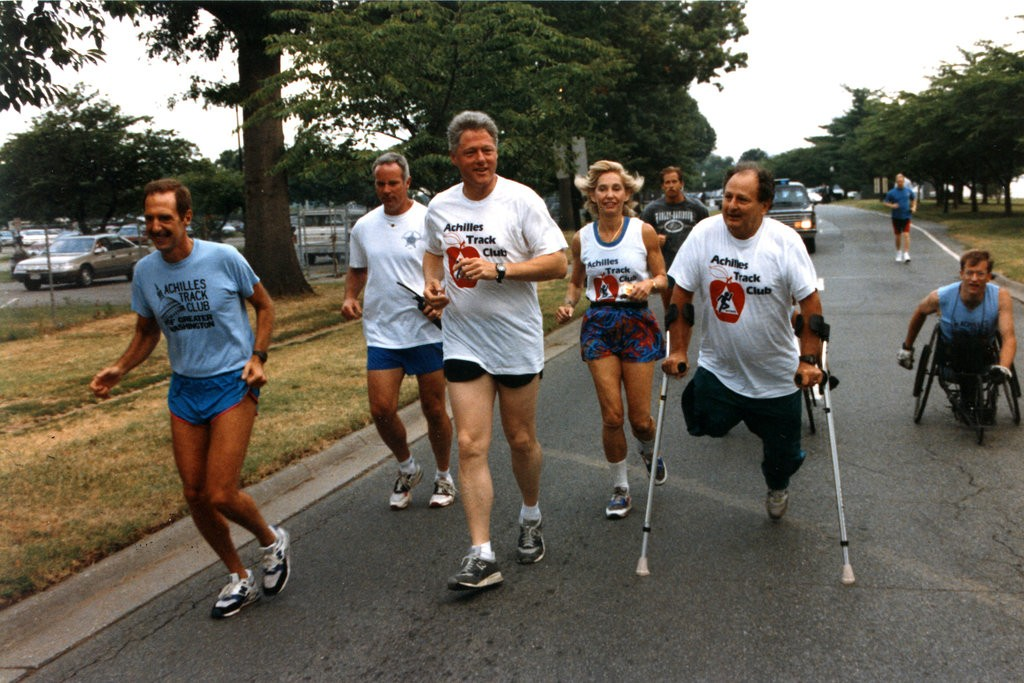 Dick Traum (right) and members of Achilles run with President Bill Clinton in Washington, D.C. in 1993. | © Courtesy of Achilles International