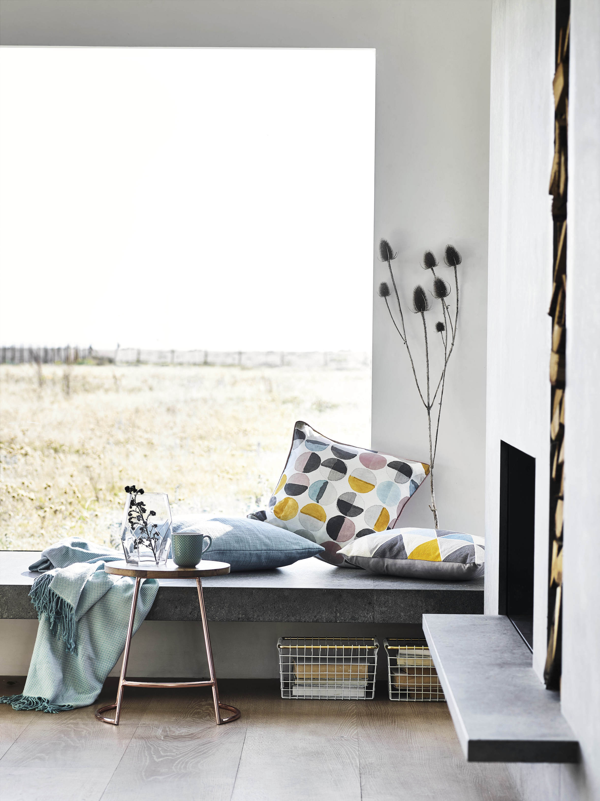 The focus of this room is all about connecting with nature through the large picture window rather than ornamentation | Courtesy of Sainsbury's