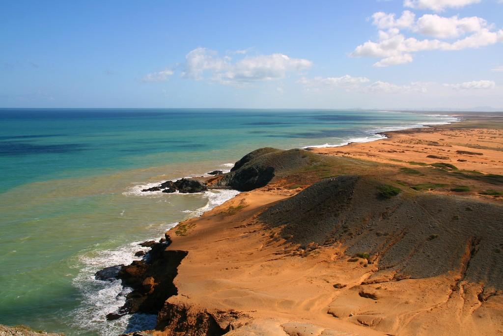 Where the bright orange of the La Guajira desert meets the Caribbean Sea © Tanenhaus / Flickr