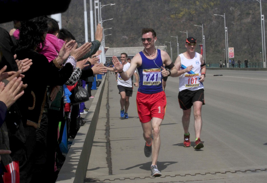 Runners high five spectators during the 2017 Pyongyang Marathon | © Kim Kwang Hyon/AP/REX/Shutterstock