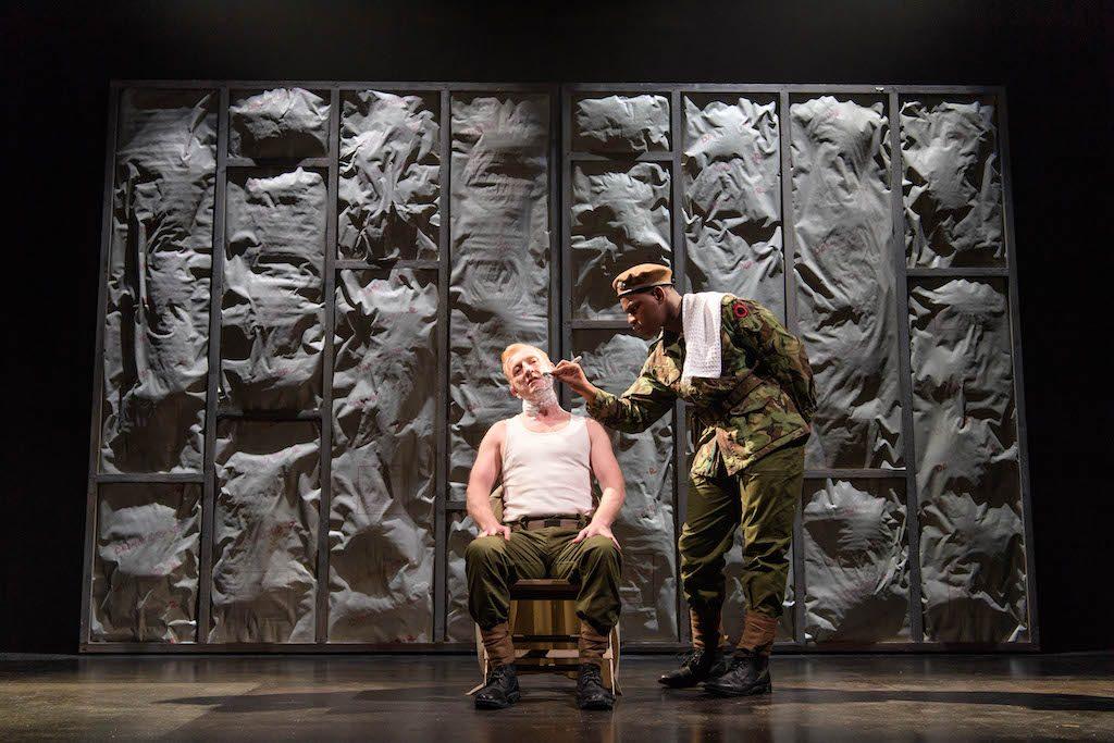 John Boyega as Woyzeck, Stefan Rhodri as the Captain   © Old Vic