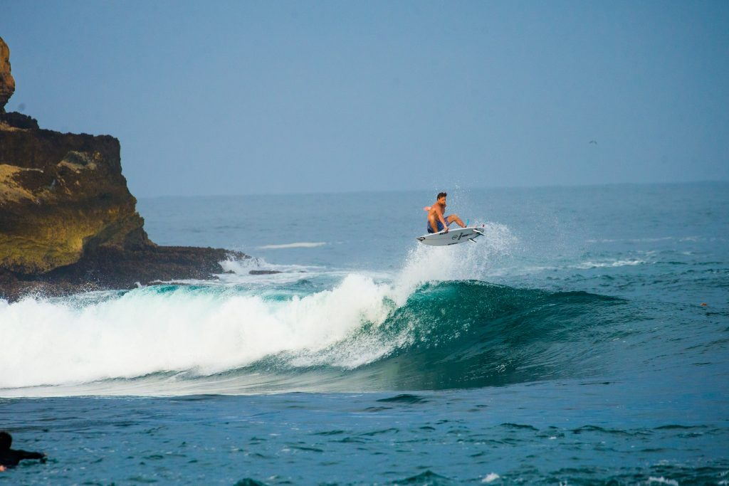 Harry Timson getting air off the coast of Java, Indonesia. | © Luke Forgay/Volcom