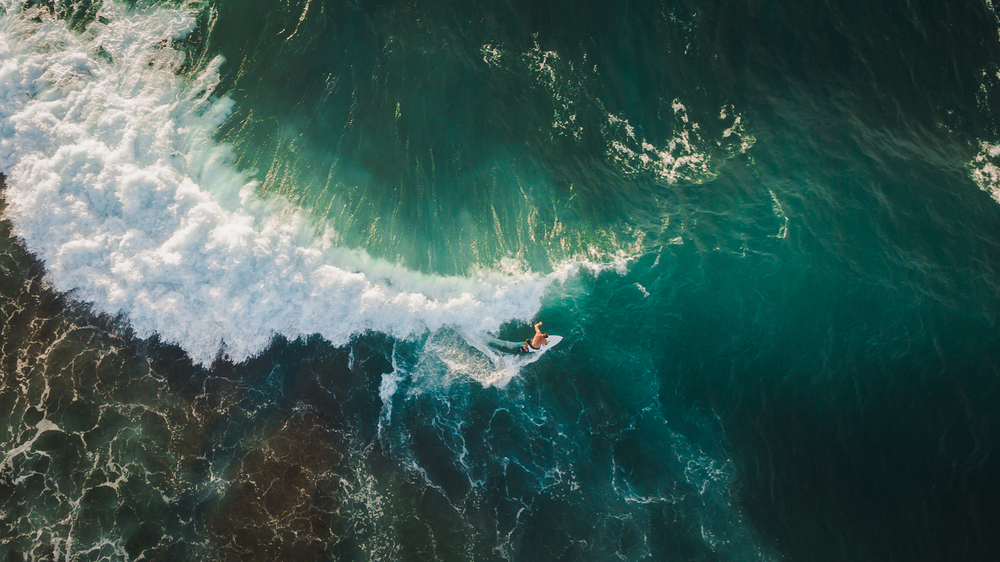 Surfer captured by drone   ©Dmitry Pustovalov/Shutterstock