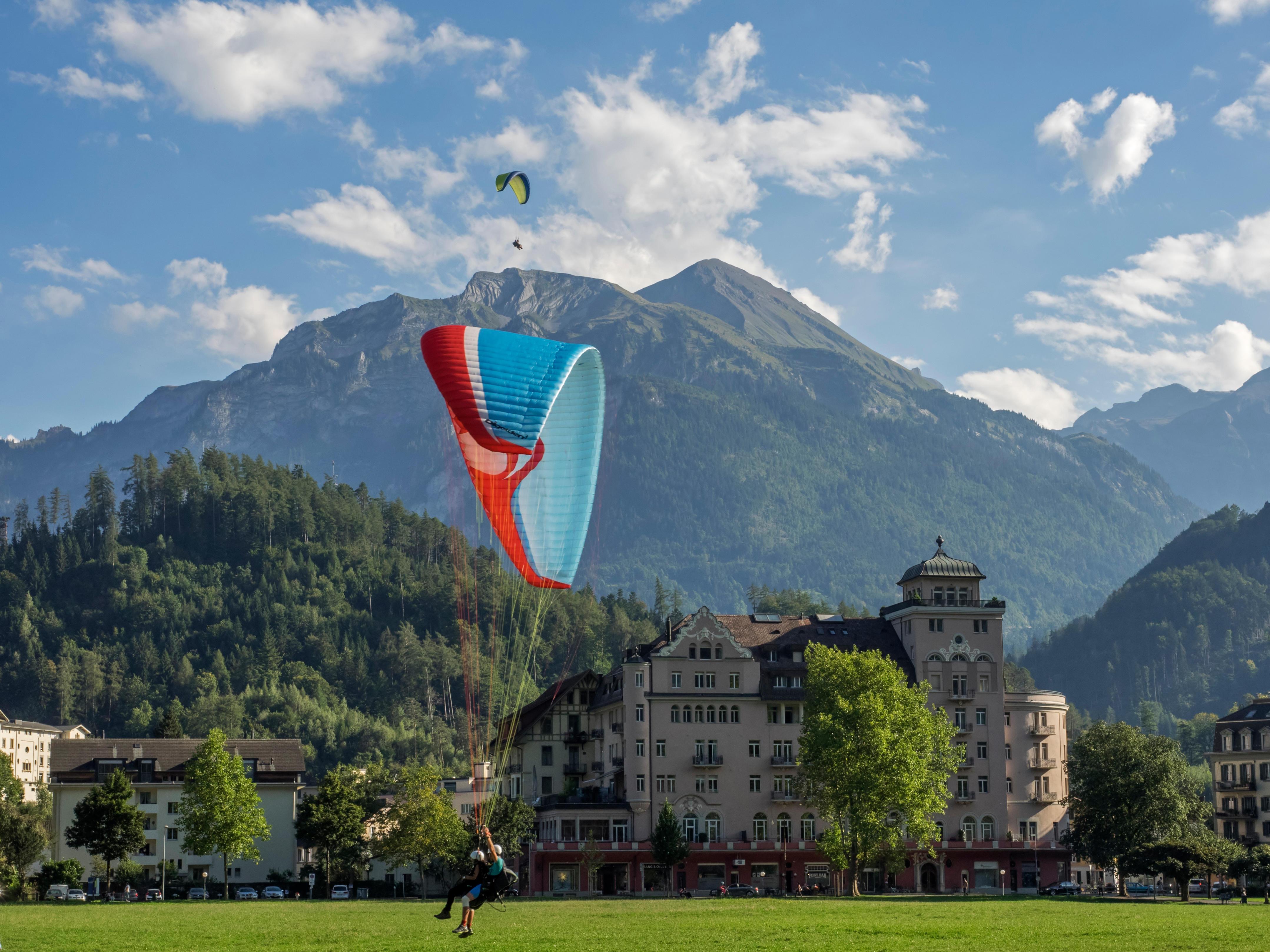Switzerland, Bern Canton, Interlaken, Paragliders, landing at Hohematte park
